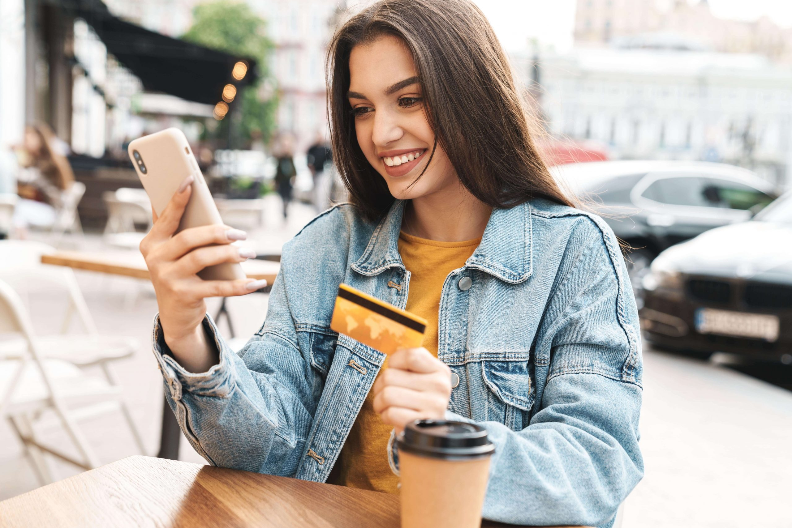 image-of-smiling-woman-using-cellphone-and-holding-DXTXRFW-min